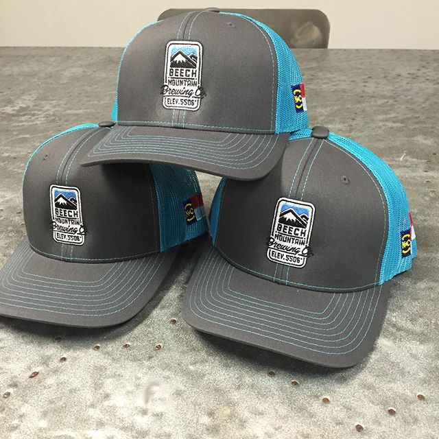 Loving these colors - they scream @panthers blue and gray however they are all about @beechmtn 's brewing company!  The #nc flag is a great new addition.  #beechmountain #dunstangroup #caps #embrodiery #winning #truckerhat #beechmtn