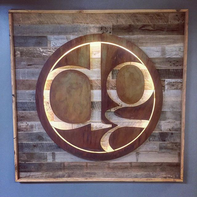Loving our custom wall decor!  #dunstangroup #signage #reclaimedwood #branding